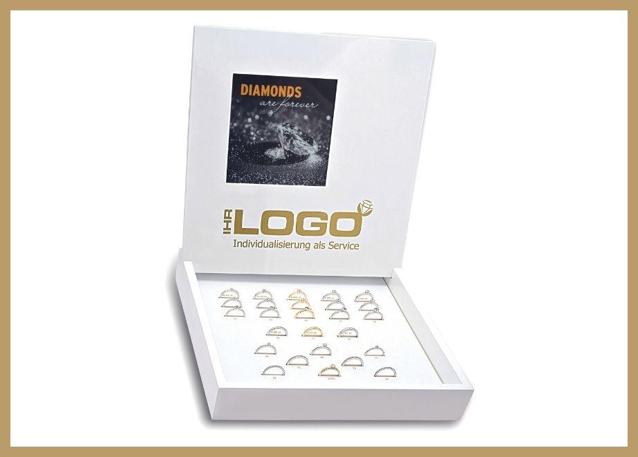 """Das breite Brillantschmuck-Angebot der BEDRA """"world of diamonds"""" gibt es in allen Preislagen. Verkaufssysteme wie die hochwertige Dummybox werden auf Wunsch mit Händler-Logo gebrandet."""