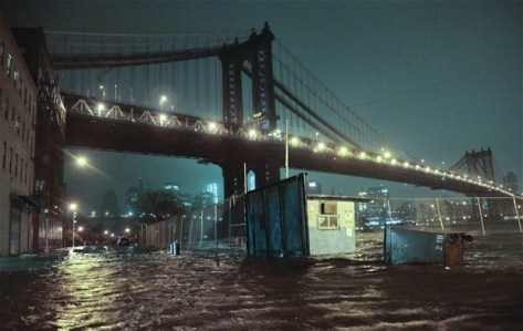 Streets are flooded under the Manhattan Bridge in the Dumbo section of Brooklyn, N.Y. Photo: AP Photo/Bebeto Matthews