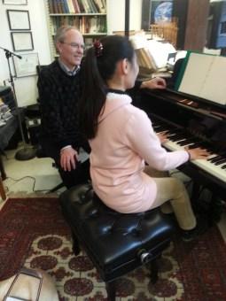 Yeaji Kim and Professor Todd Welbourne at a piano.