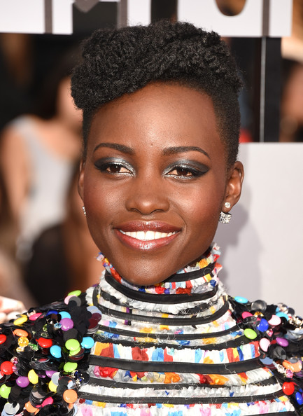 Lupita Nyong'o wearing Chanel at 2013 MTV Movie Awards. Makeup by Nick Barose for Lancome.
