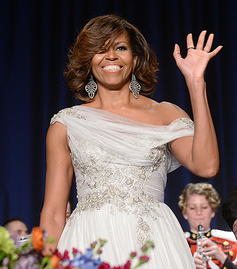 michelle-obama-side swoop bangs and highlights hair