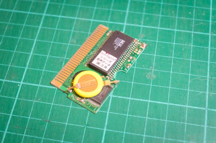 Position the new battery onto the board