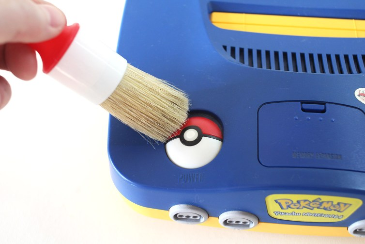 Use a soft bristled brushto clean dust