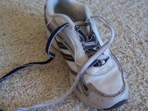 Lace the shoe normally with the newly tied-together shoelace.