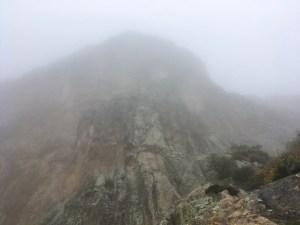 A Peña de Bernal shrouded in fog on a rainy Saturday.