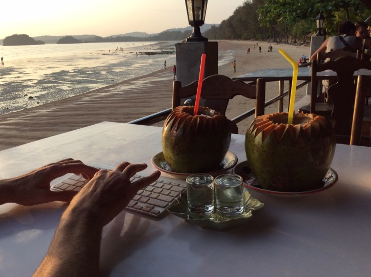 Typing at beach bar in at Ao Nang... on a Bluetooth coconut?!?