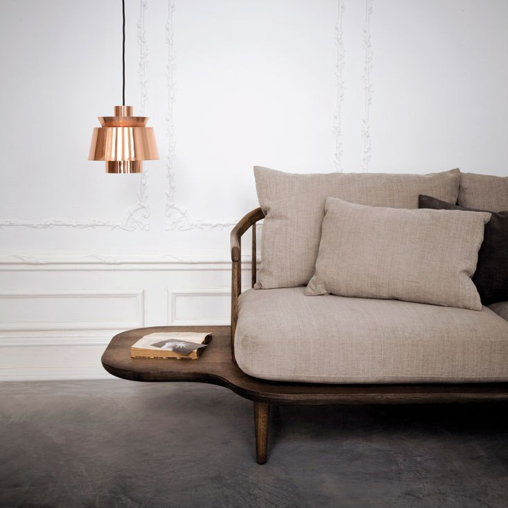 Bronze hangin lamp and beige sofa