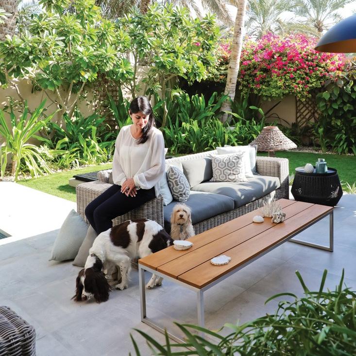 Emma in her garden living area