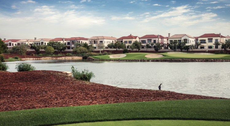 A view of Jumeirah Golf Estates in front of a lake