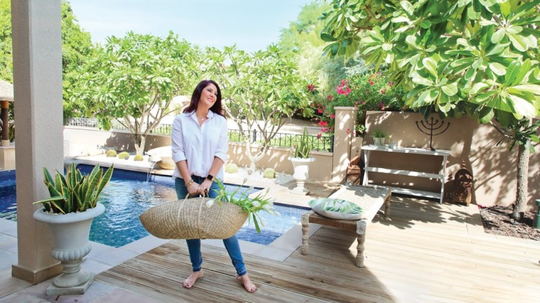 Woman in a backyard garden and pool