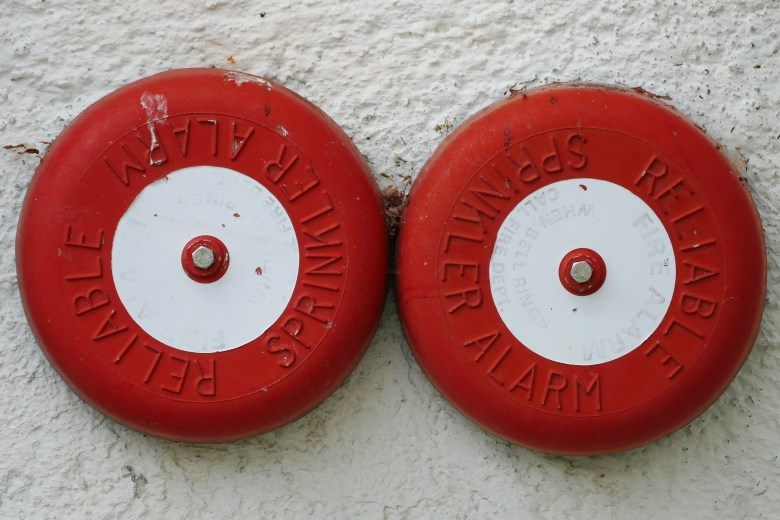 two red fire detectors alarms