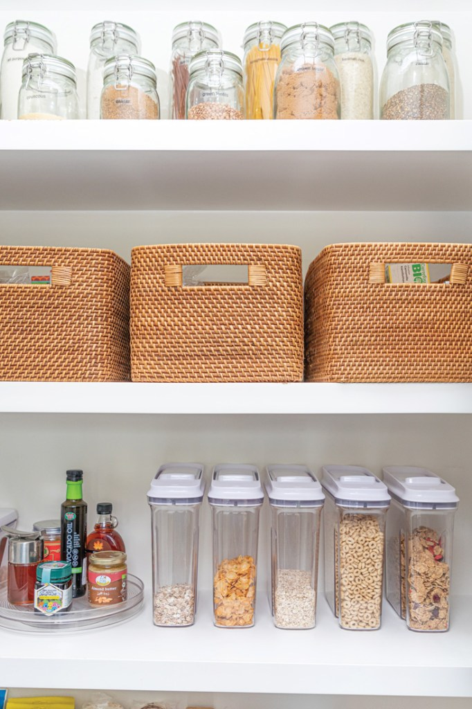 Wicker baskets and containers on shelves