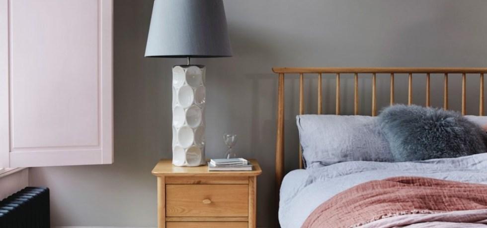 Pink bedroom with grey walls