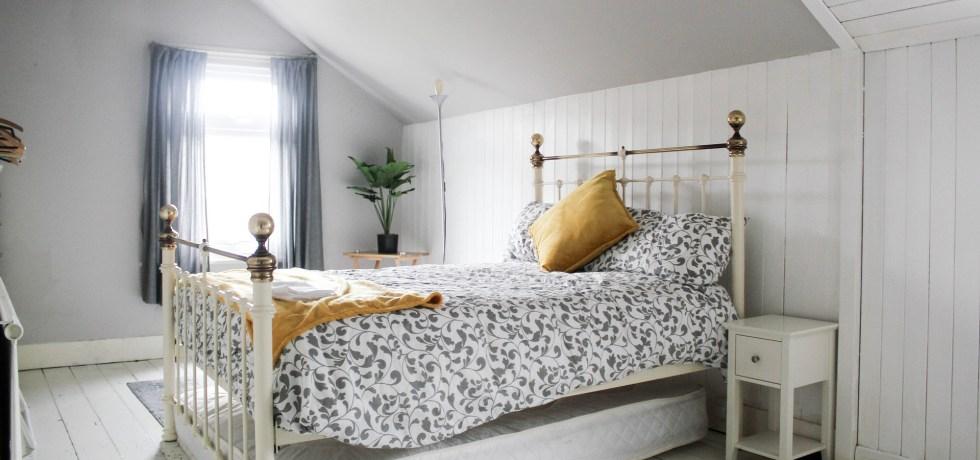 bedroom white clean decluttered light