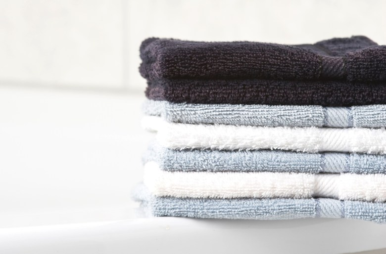 stack of towels grey white blue