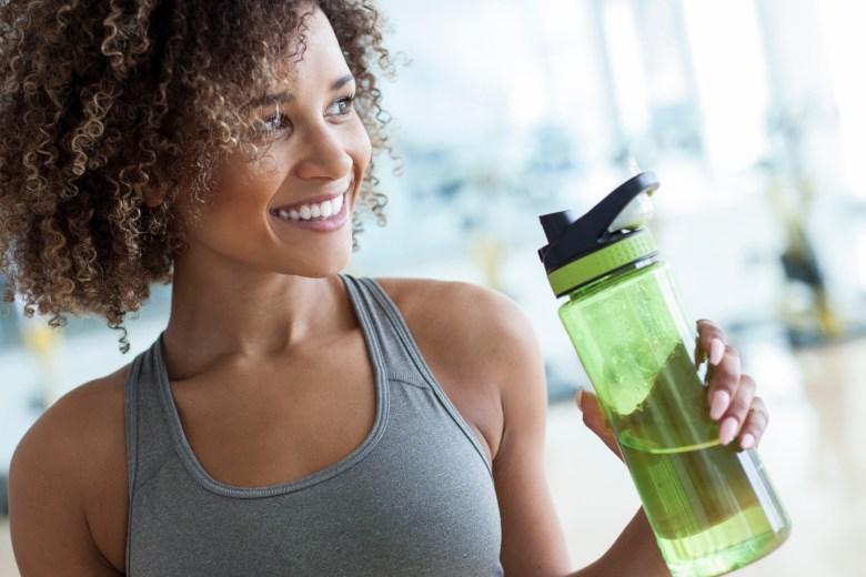 woman sports bra water bottle