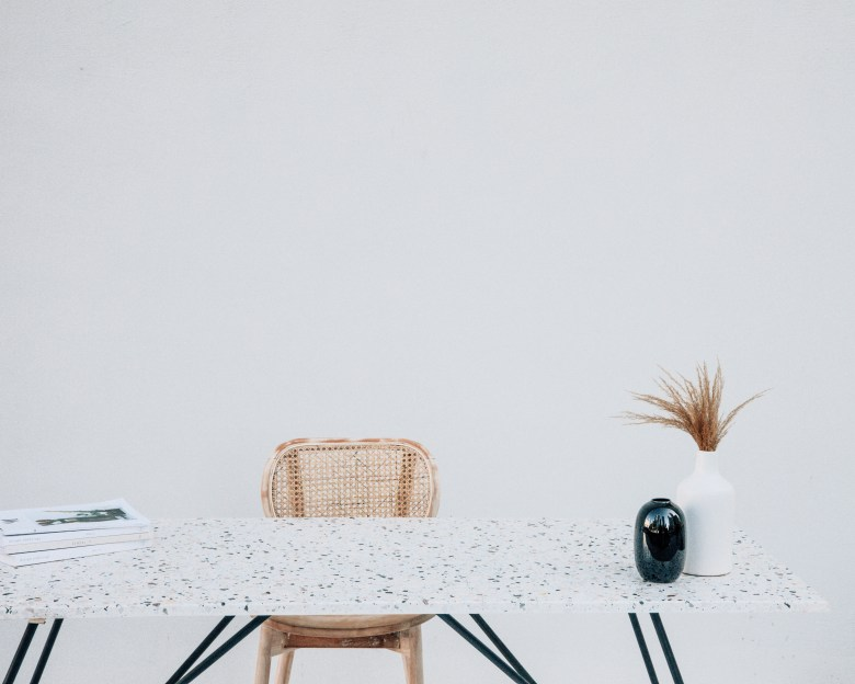 Simple marble table with rattan chair