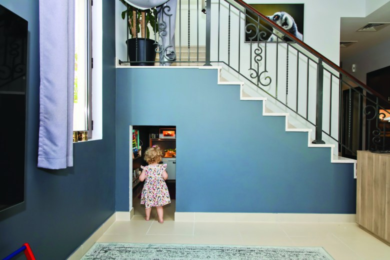 Under stair playroom by Handy Scandy