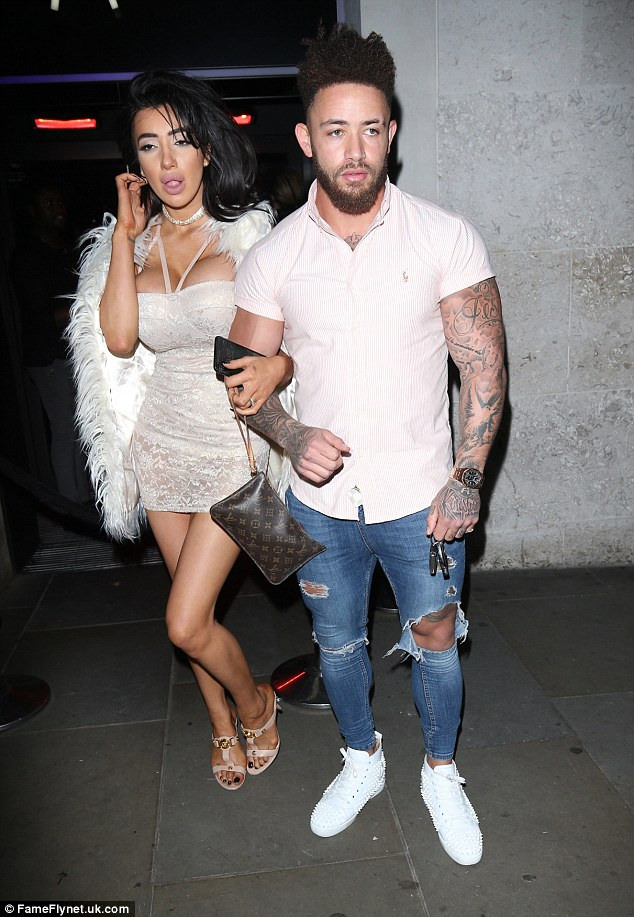Overdone it slightly? Chloe Khan and her new boyfriend Ashley Cain looked a tad bleary-eyed as they headed inside