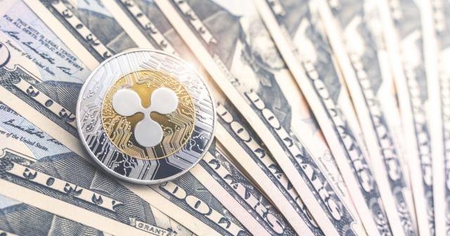 Ripple coin on US dollar bills