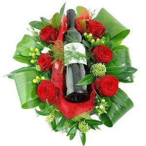 Bloemstuk met fles rode wijn bestellen of bezorgen online