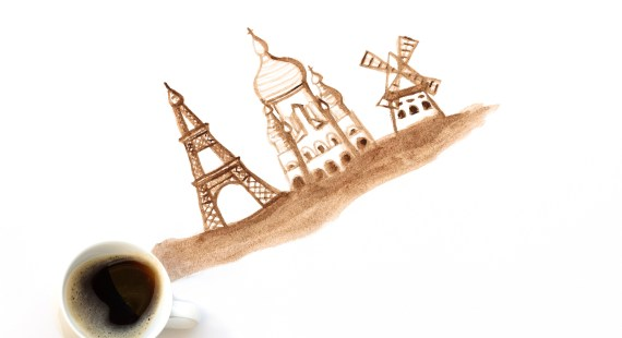 Espresso cup with hand drawing attractions of Paris, France. Coffee art or creative concept. Top view