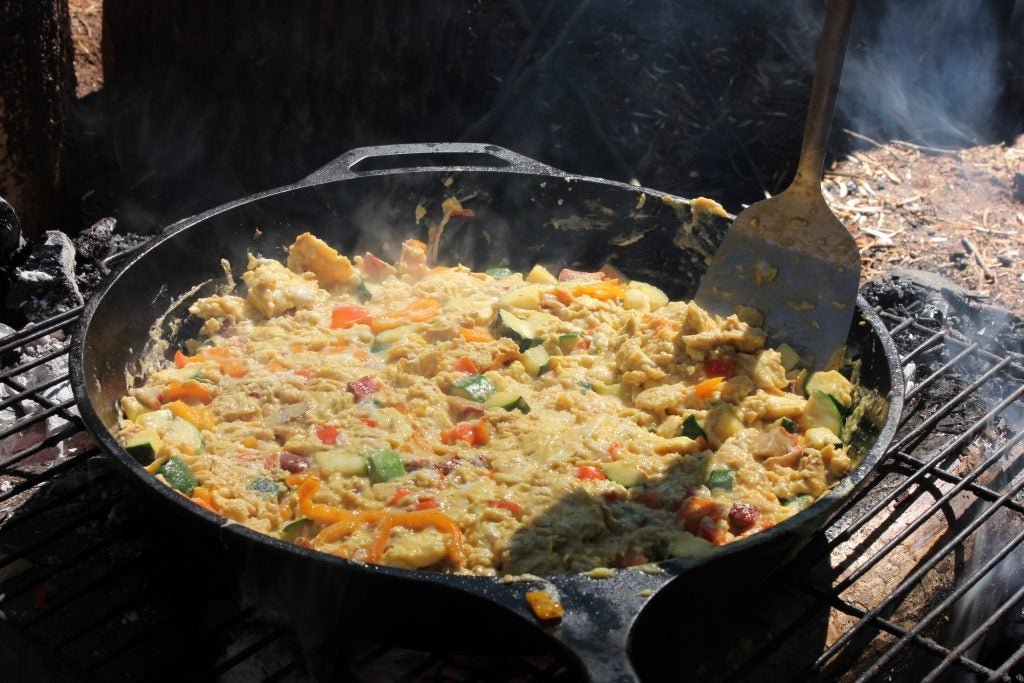 Scramble some eggs for a kid friendly camping recipe.