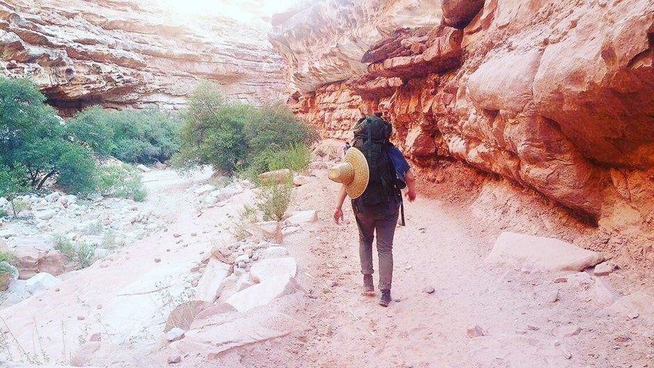 hiker on trail while camping in Havasu Falls
