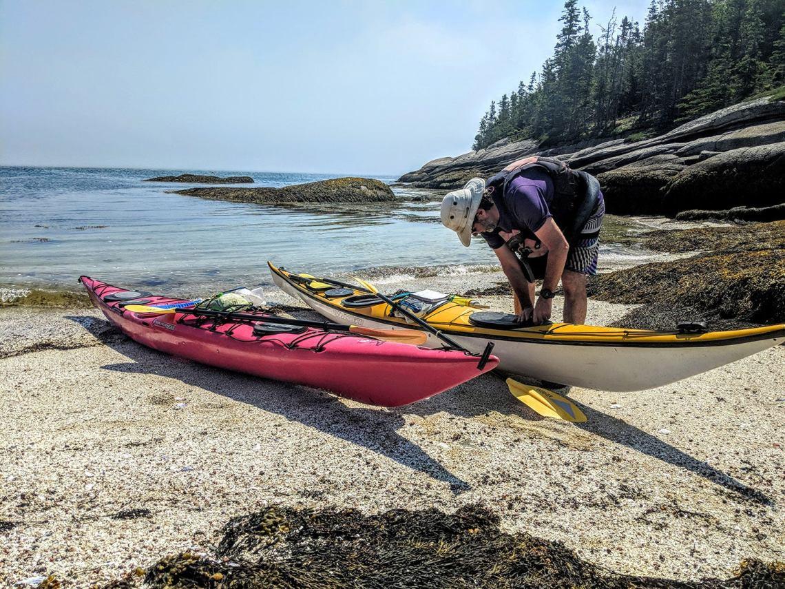 hutch preparing his sea kayak