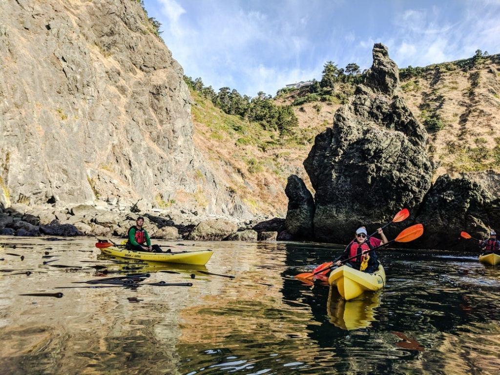 kayakers paddling at eco-resort at Cape Blanco State Park