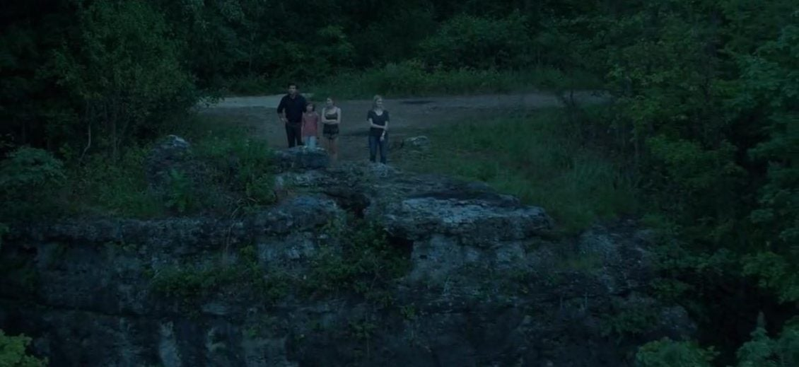 ozark tv screencap of the Byrde family staring out over a bluff in the forest at night
