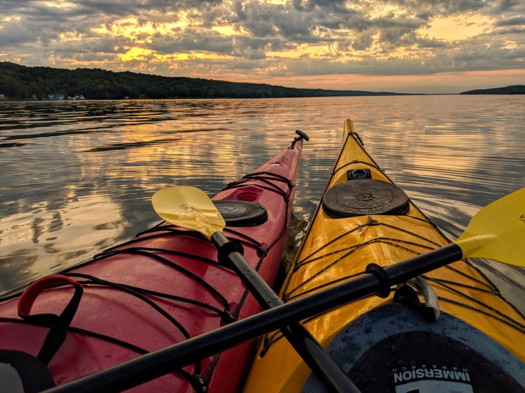 Two kayaks together at sunset