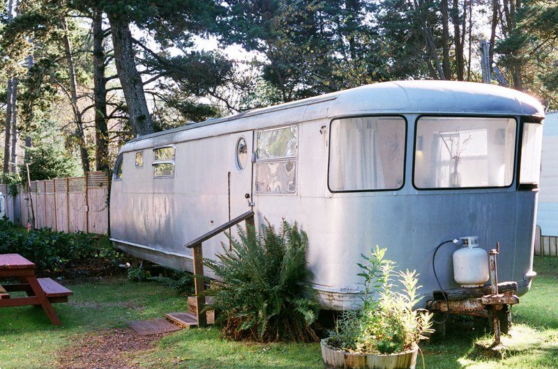 a vintage trailer made of steel rests grounded at the Sou'wester Lodge in Washington