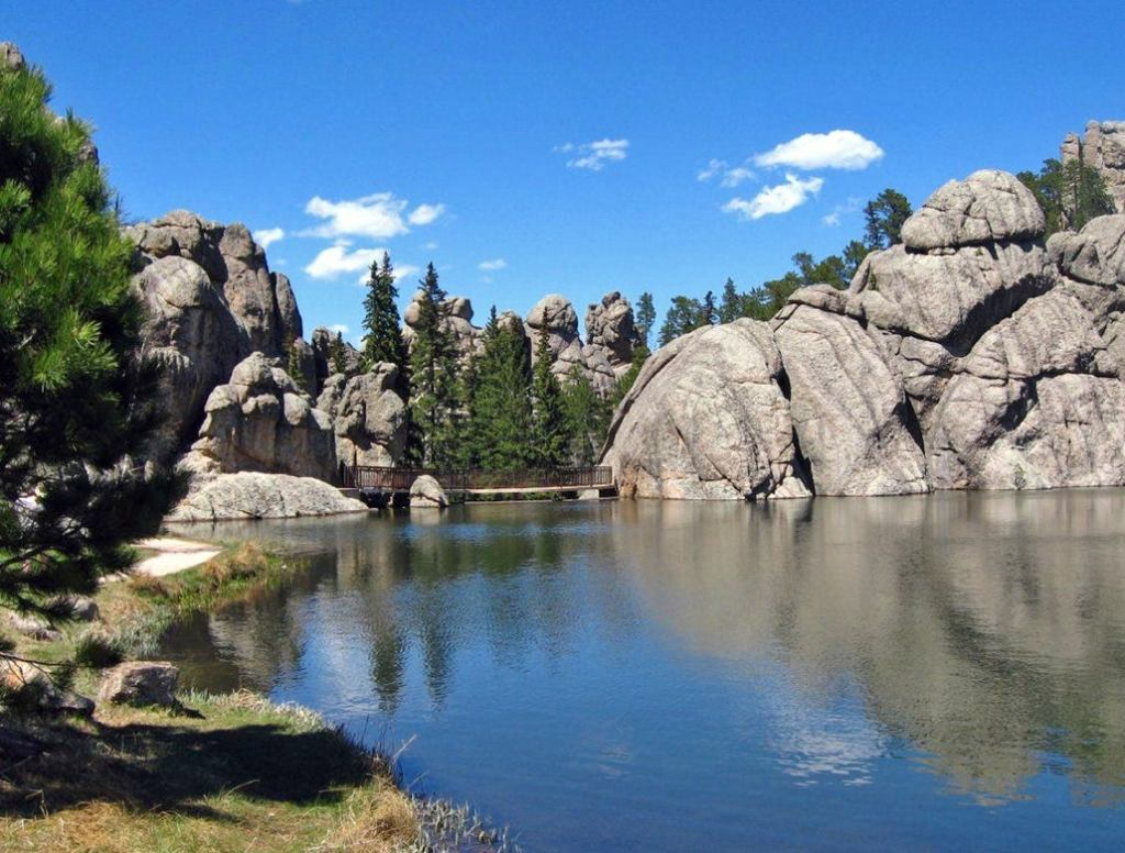 sylvan lake nestled in tall pines and round rocks