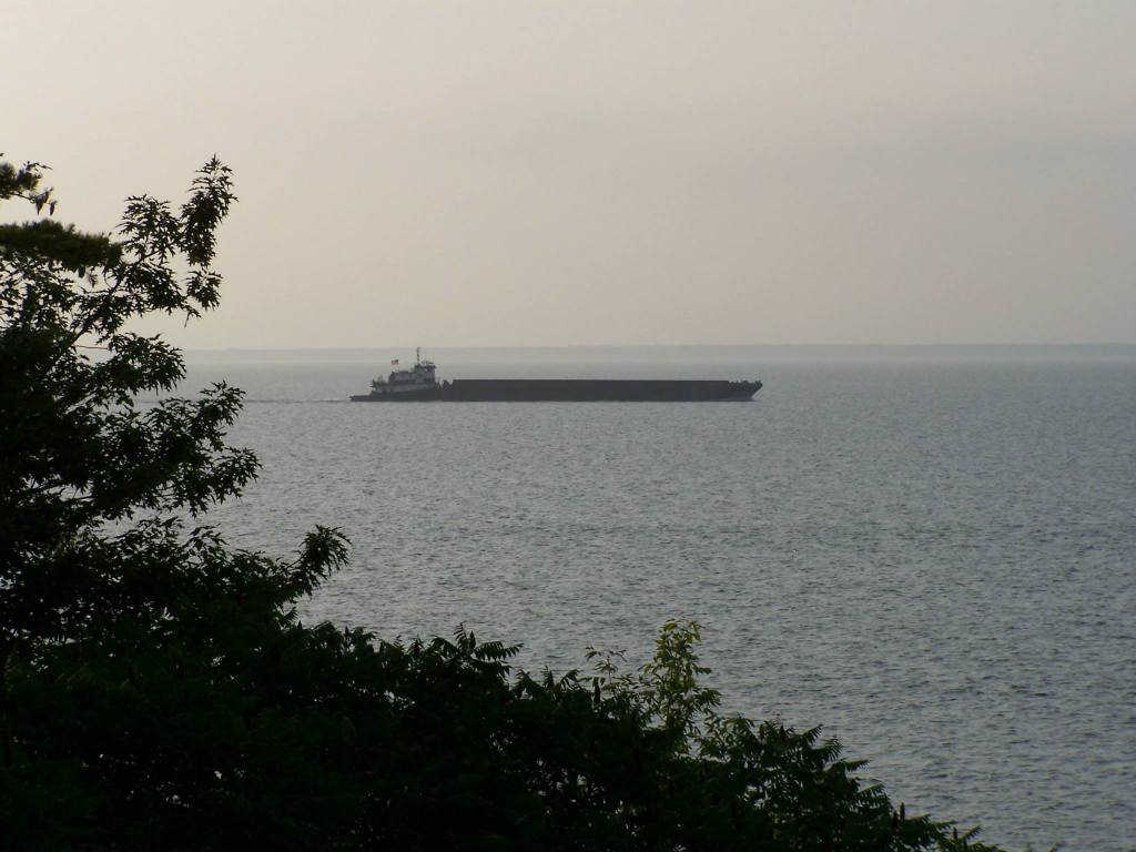 a ship dry docked on a sand bar in the great lakes