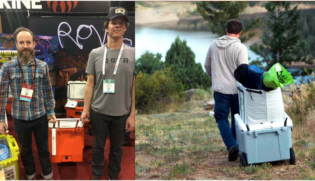 two men attending outdoor retailer hold a cooler by a handle (right) one man rolling a cooler down a hill filled with gear