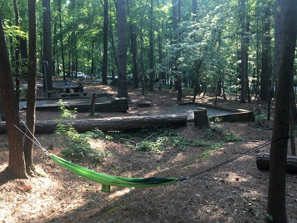 Campground with forest and green hammock in foreground