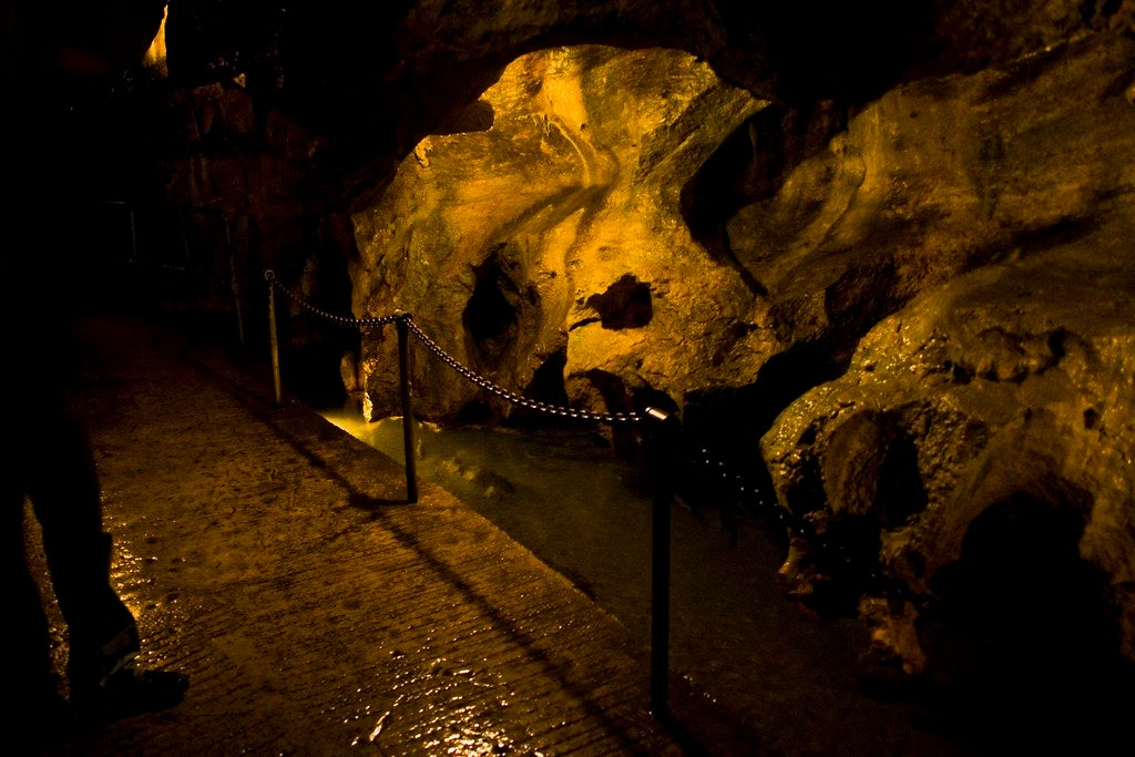 a dark cavern with a stone pathway leading through in Linville, NC