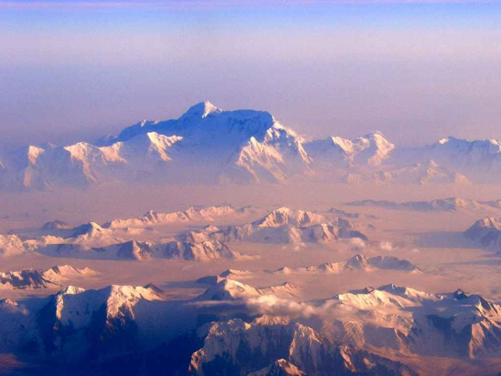pink fog and alpine glow of snow covered Mount St. Elias and surrounding mountains