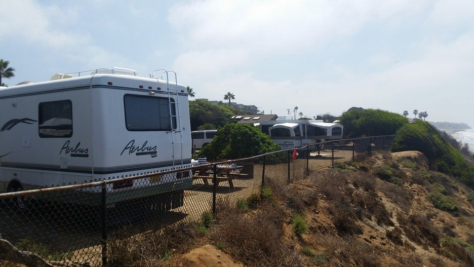 RVs parked on the edge of the beach at South Carlsbad State park