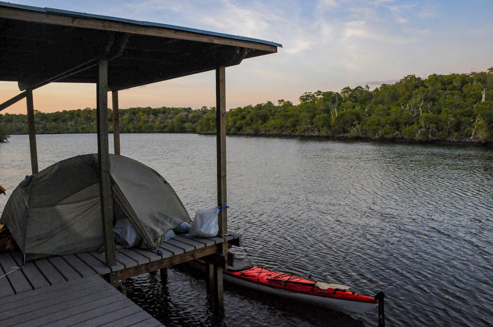 Tent setup and kayak tied up at the Shark River chickee.