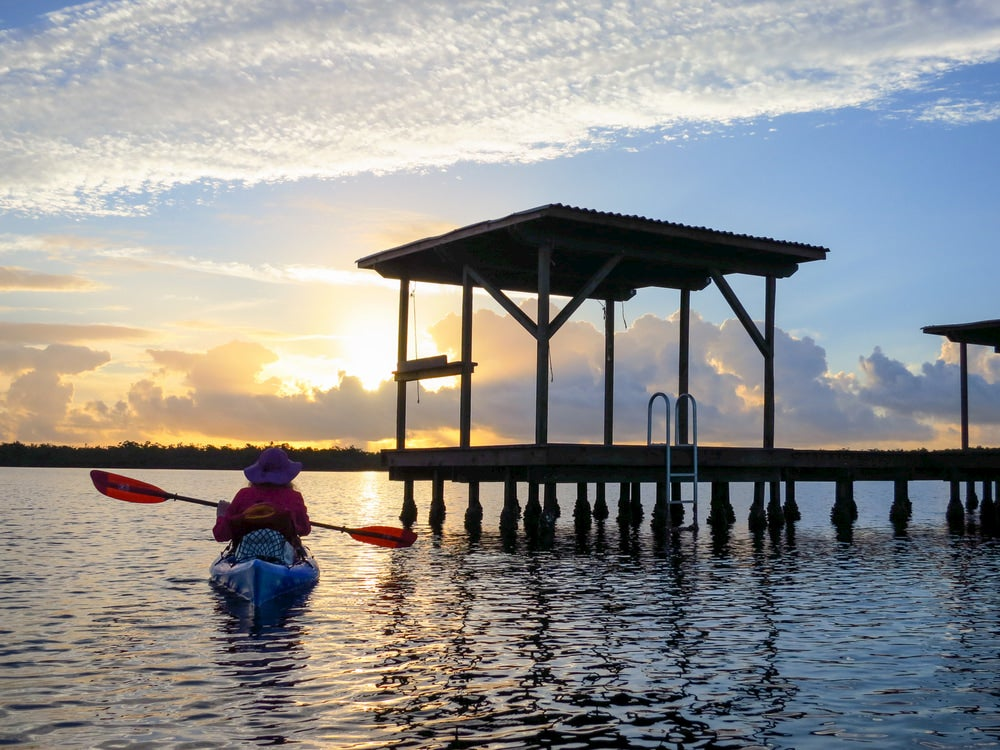 Kayaker approaching a chickee on the Everglades.