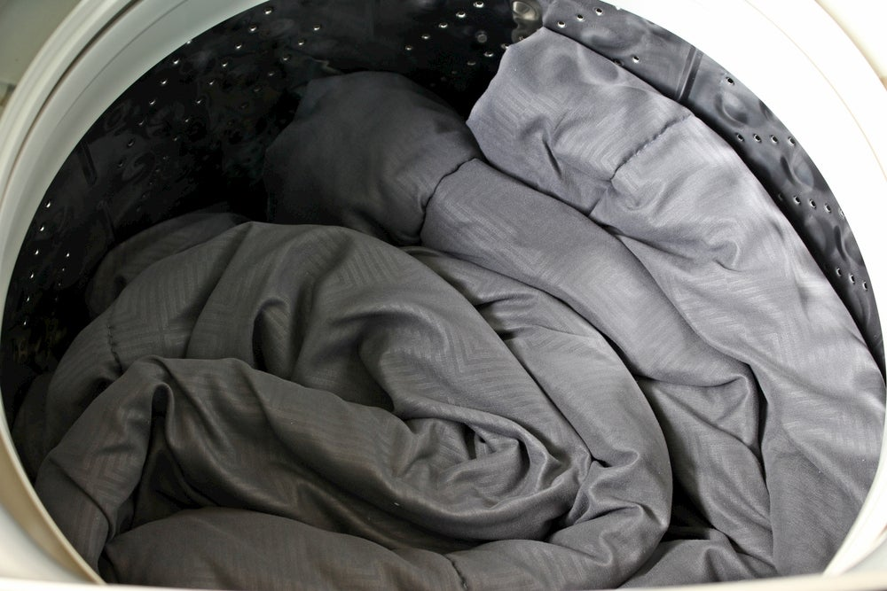 Sleeping bag in a washing machine.