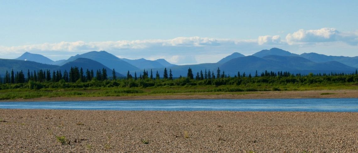 River and surrounding sandy banks in the mounain landscape of Kobuk Valley National Park.
