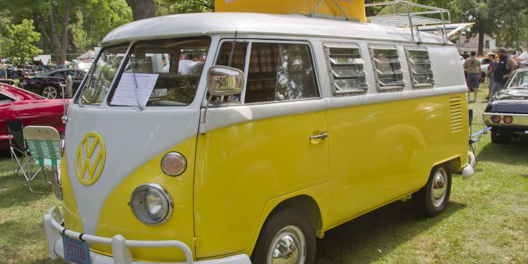 a volkswagon pop-up camper painted bright yellow