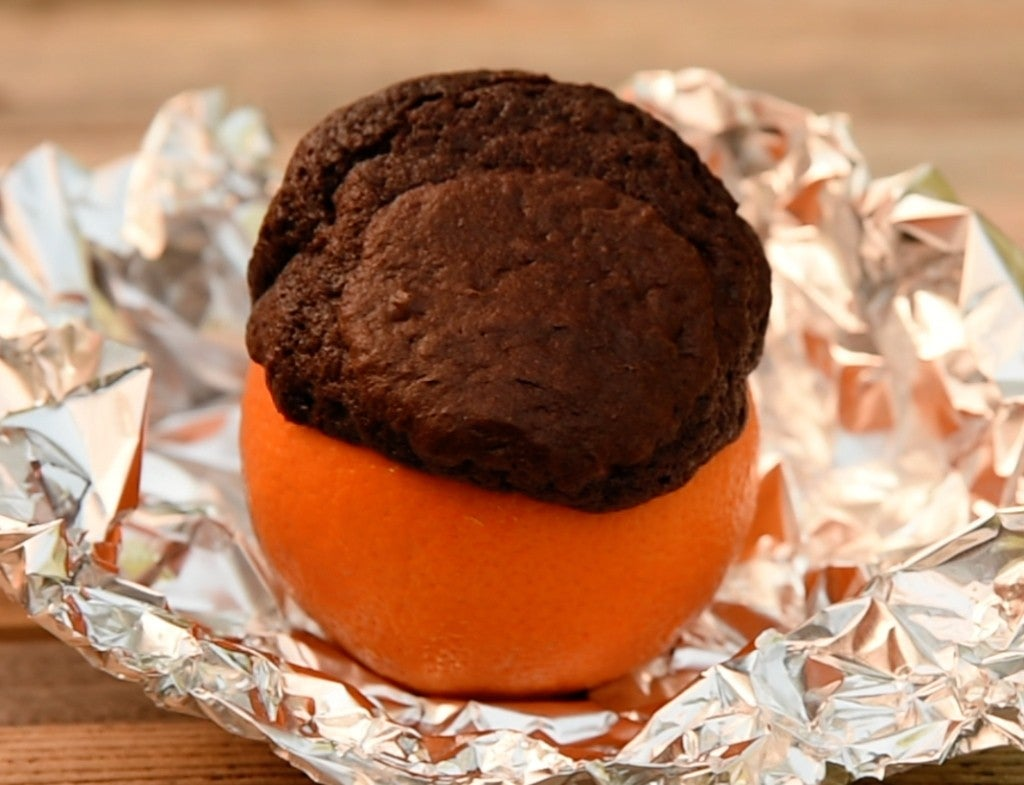 a brownie cooked in an orange in tin foil