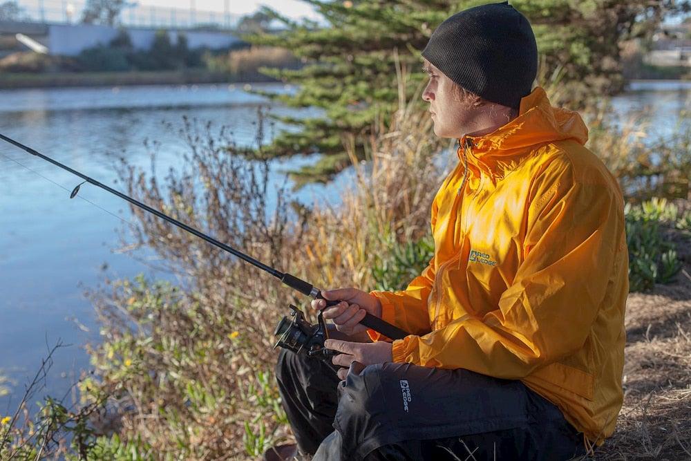 Man wearing yellow jacket fishing