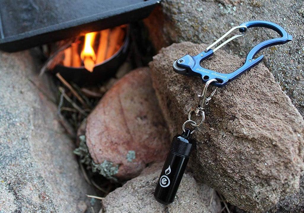 Outdoor Element firebiner resting on a rock.