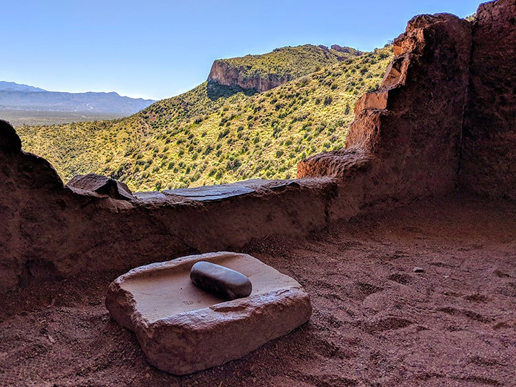 a rocky outcropping overlooking the valley near the mountains in arizona