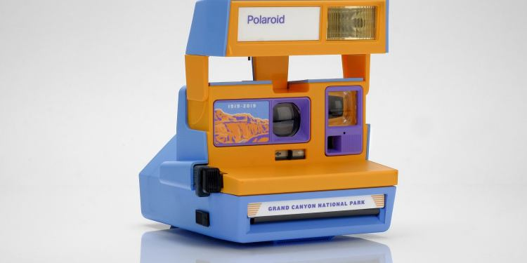 a polaroid camera in a grand canyon design